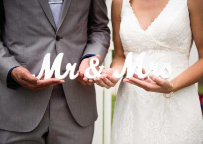 "white wooden ""Mr. & Mrs."""